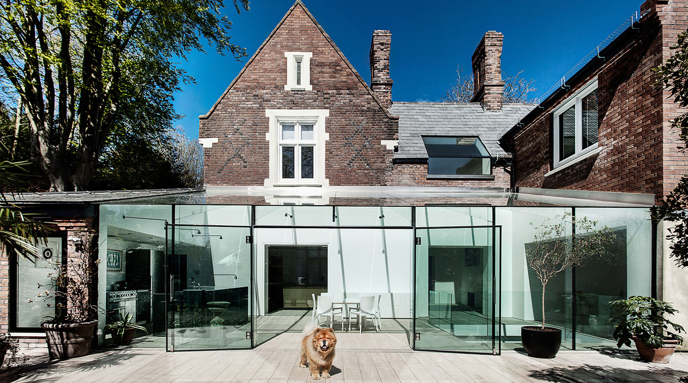 Historic residential building in a modern glass robe